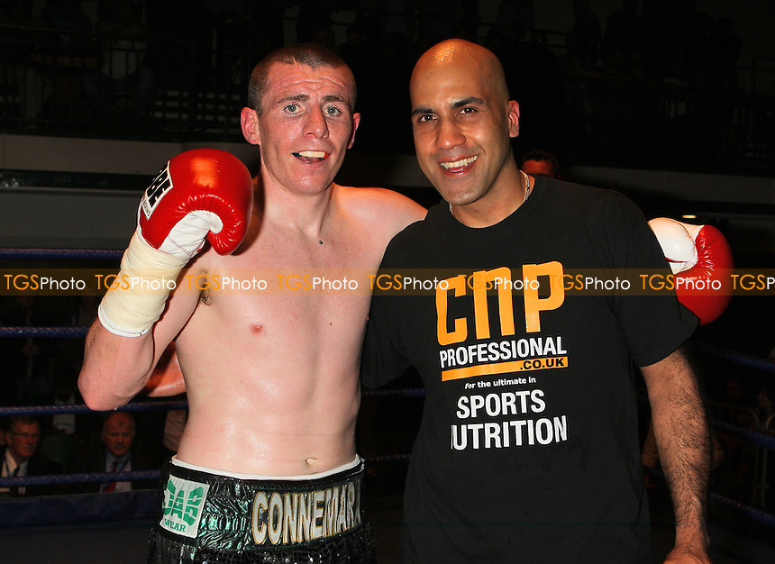 Peter McDonagh (Bermondsey, black/green shorts) defeats Jimmy Briggs in a Light-Welterweight boxing contest at York Hall, Bethnal Green, promoted by Micky Helliet, Hellraiser Promotions - 12/06/09 - MANDATORY CREDIT: Gavin Ellis/TGSPHOTO - Self billing applies where appropriate - 0845 094 6026 - contact@tgsphoto.co.uk - NO UNPAID USE.