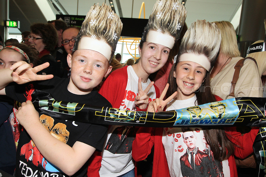 15/5/11 Fans Emmet Carroll (left), Kelly Dodrill and Jade Dodrill, Dublin wait for Jedward to arrive home at T2 Dublin Airport after finishing in 8th place at the Eurovision Song Contest in Dusseldorf, Germany. Picture:Arthur Carron/Collins