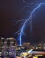 Lightning strike bolt thunderstorm monsoon storm thunderstorm downtown Phoenix Arizona city sky lights urban chaser chasing building Bank of America building