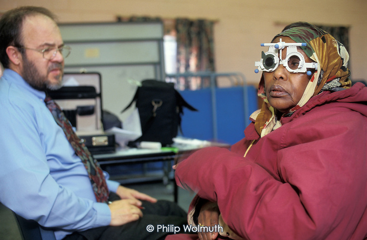 A woman receives an eye test during a visit by Mobile Optical Services to the Rockingham Somali Support Group in the Rockingham Estate Community Centre, Southwark.