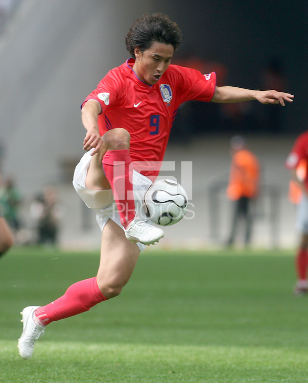 Korea Republic's Jung Hwan Ahn takes the ball on the run. Korea Republic defeated Togo 2-1 in their FIFA World Cup Group G match at the FIFA World Cup Stadium, Frankfurt, Germany, June 13, 2006.