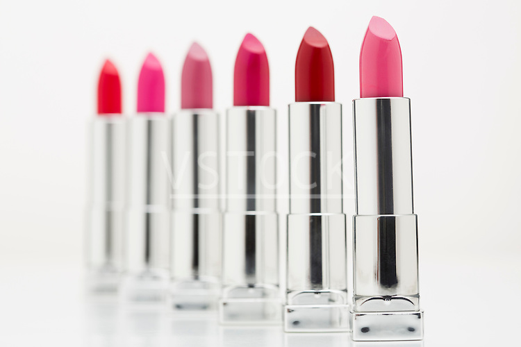 Various lipsticks on white background