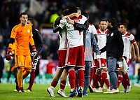 Olympiakos players celebrate after the final whistle <br /> <br /> Photographer Alex Dodd/CameraSport<br /> <br /> UEFA Europa League - UEFA Europa League Qualifying Second Leg 2 - Burnley v Olympiakos - Thursday August 30th 2018 - Turf Moor - Burnley<br />  <br /> World Copyright © 2018 CameraSport. All rights reserved. 43 Linden Ave. Countesthorpe. Leicester. England. LE8 5PG - Tel: +44 (0) 116 277 4147 - admin@camerasport.com - www.camerasport.com