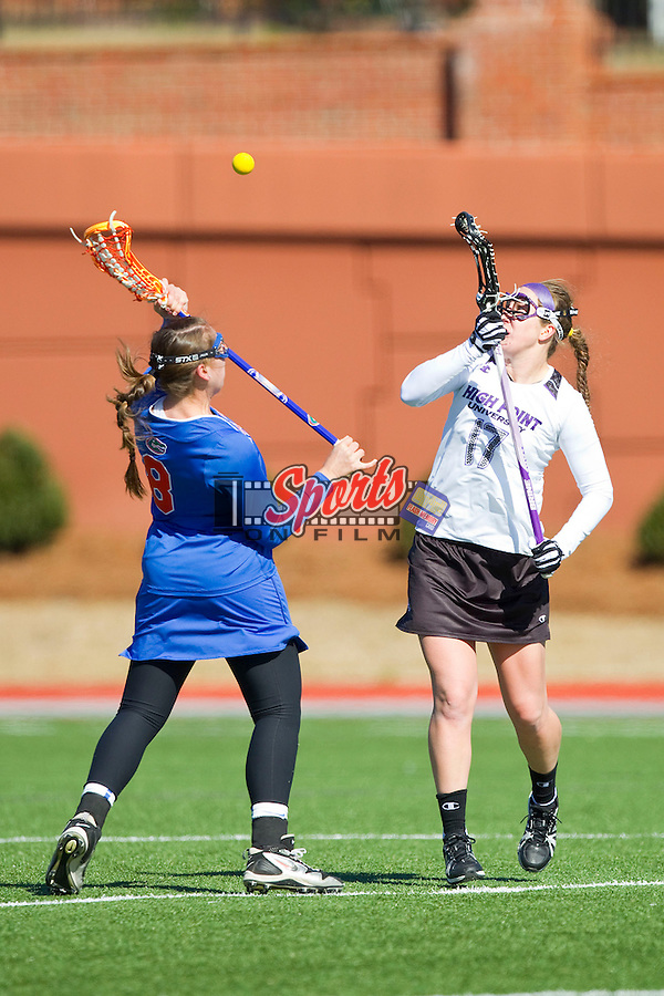 Stephanie Pazulski (17) of the High Point Panthers faces off against Shannon Gilroy (8) of the Florida Gators during second half action at Vert Track, Soccer & Lacrosse Stadium on February 17, 2013 in High Point, North Carolina.  The Gators defeated the Panthers 13-7.   (Brian Westerholt/Sports On Film)