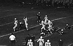 "Bethel Park PA:  Offensive play with Mike Stewart 11 throwing the ball away.  The offensive line was unanimous in yelling ""look out"" on this play!  Others in the photo; Clark Miller 30, Don Troup 51, Glenn Eisaman 71, Joe Barrett 75. Uniontown was coached by long-term Upper St Clair Coach Jim Render and big time college and pro running back Chuck Muncie.  The offense and defense played well enough to win 21-14.  This was the most points given by the defense all year.  The defensive unit was one of the best in Bethel Park history only allowing a little over 7 points a game."