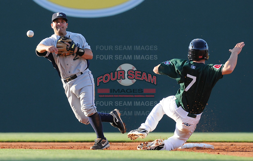 Zach Gentile (7) of the Greenville Drive is out at second as Lexington Legends second baseman Jose Altuve (2) turns the double play in a game on April 25, 2010, at Fluor Field at the West End in Greenville, S.C. Photo by: Tom Priddy/Four Seam Images