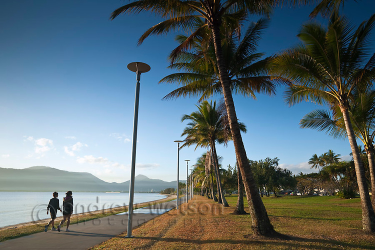 Early morning walkers on the Esplanade.  Cairns, Queensland, Australia