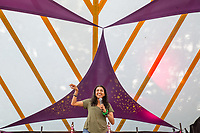 Comedian Sindhu Vee  performs on day 2 of the 2019 Latitude Festival at Henham Park, Suffolk. 20th July 2019<br /> <br /> Photo by Stuart Hogben