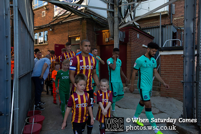 Bradford City 3, Carlisle United 1, 21/09/2019. Valley Parade, EFL League 2. The teams making their way onto the pitch before Bradford City (in claret and yellow) played Carlisle United in a Skybet League 2 fixture at Valley Parade. The home team were looking to bounce back after being relegated during a disastrous 2018-19 season on and off the pitch. Bradford won the match 3-1, watched by a crowd of 14, 217. Photo by Colin McPherson.