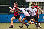 Halcyon Quintin Salter Price (l) of Singapore fights for the ball with Younes Alblooshi of United Arab Emirates during the match between United Arab Emirates and Singapore of the Asia Rugby U20 Sevens Series 2016 on 12 August 2016 at the King's Park, in Hong Kong, China. Photo by Marcio Machado / Power Sport Images
