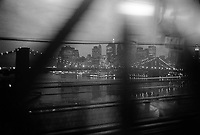 USA. New York state. New York City. View on Manhattan Bridge at nighttime from a moving subway to Downtown Manhattan. 10.05.04 © 2004 Didier Ruef