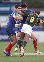 French second row Yoann Maestri is tackled by  Marlin Ruiters during the Division A U19 World Championship clash against South Africa at Ravenhill.