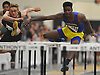 Alberto Laguerre of Lawrence, right, races to victory in the boys 55 meter hurdles event in a Nassau County indoor track and field meet at St. Anthony's High School on Wednesday, Nov. 30, 2016.