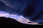 Sunset over Sierra Navada Range as a storm builds over the eastern slope.
