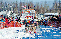 Iditarod veteran musher Dee Dee Jonrowe and dogsled team leaves the gate at the Restart of Iditarod 2012, Willow, Alaska, March 4, 2012