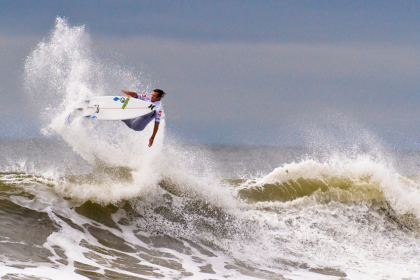 LONG BEACH, NY - SEPTEMBER 8: Brett Simpson (USA) competes in the 2011 Quiksilver Pro New York, an inaugural ASP World Tour event, on September 8, 2011 in Long Beach, NY. The Association of Surfing Professionals (ASP) World Championship Tour is the premier professional surfing tour with the world's best surfers and the world's best waves.