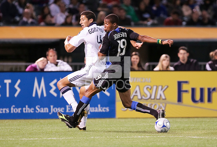 Omar Gonzalez (4) and Ryan Johnson (19) battle for the ball. San Jose Earthquakes tied Los Angeles Galaxy 1-1 at the McAfee Colisum in Oakland, California on April 18, 2009.