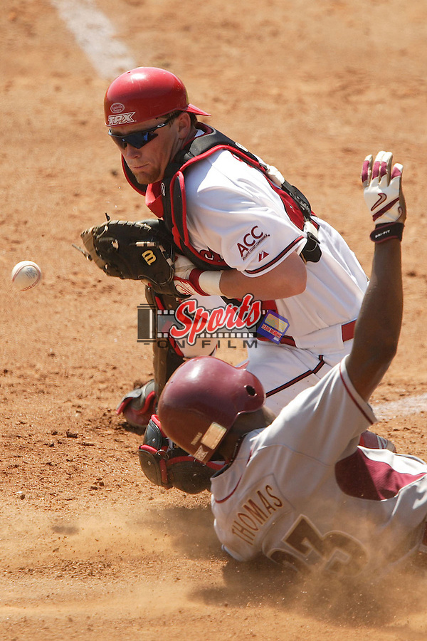 North Carolina State's Jon Still (45) can't hold on to the ball as Florida State's Tony Thomas Jr. scores at the 2006 ACC Baseball Championship at the Baseball Grounds of Jacksonville in Jacksonville, FL, Saturday, May 27, 2006.  Florida State defeated North Carolina State 7-3.