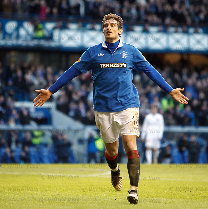 Nikica Jelavic celebrates his hat-trick goal