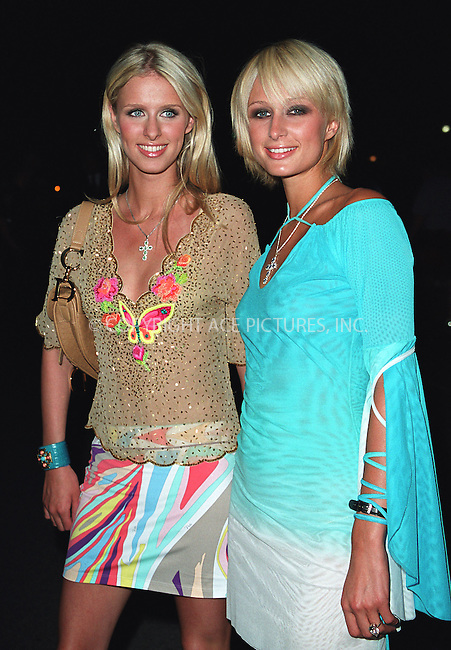 Nicky (Nikki) and Paris Hilton attend amfAR's 11th Annual Boathouse Rock event at Tavern on the Green. New York, June 17, 2002. Please byline: Alecsey Boldeskul/NY Photo Press.   ..*PAY-PER-USE*      ....NY Photo Press:  ..phone (646) 267-6913;   ..e-mail: info@nyphotopress.com