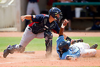 Catcher Charles Vazquez #10 of AABC tags out Addison Russell #21 of Dixie as he tries to score at the 2011 Tournament of Stars at the USA Baseball National Training Center on June 25, 2011 in Cary, North Carolina.  The AABC defeated Dixie 4-2.  (Brian Westerholt/Four Seam Images)
