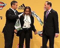 Caleb Porter coach of the University of Akron with the mother of Darlington Nagbe first pick of the Portland Timbers with commissioner Don Garber at the 2011 MLS Superdraft, in Baltimore, Maryland on January 13, 2010.