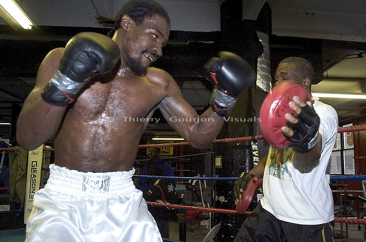 WBC Cruiserweight Champion Wayne Braithwaite (L) works the mitts with trainer Colin Morgan (R)  at Gleason's Gym in Brooklyn, New York before his April 2nd Title Fight against WBA Champion Jean-Marc Mormeck in Worcester MA, on Thursday 24, 2005.