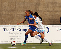 Allston, Massachusetts - May 15, 2014: First half action. In a National Women's Soccer League (NWSL) match, Boston Breakers (blue) vs Chicago Red Stars (whte/blue), 1-1(halftime), at Harvard Stadium.