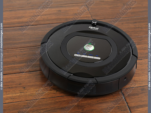 iRobot Roomba 770 household vacuum cleaning robot on hardwood floor