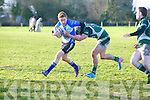Tralee's Farrell O Nuallain and Kanturk's Luke McCabe in action in the Munster Junior Shield at O'Dowd park, Tralee on Sunday.