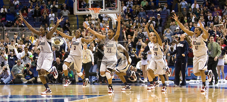 040709TVWOMENFINALFOUR12.UConn starting players - who had been subbed out with seconds to go in the game - rush their substitute players on the court  to celebrate after defeating Louisville 76-54 at the NCAA Women's Final Four at the Scottrade Center in St. Louis, MO on Tuesday April 7, 2009..MCT/TIM VIZER