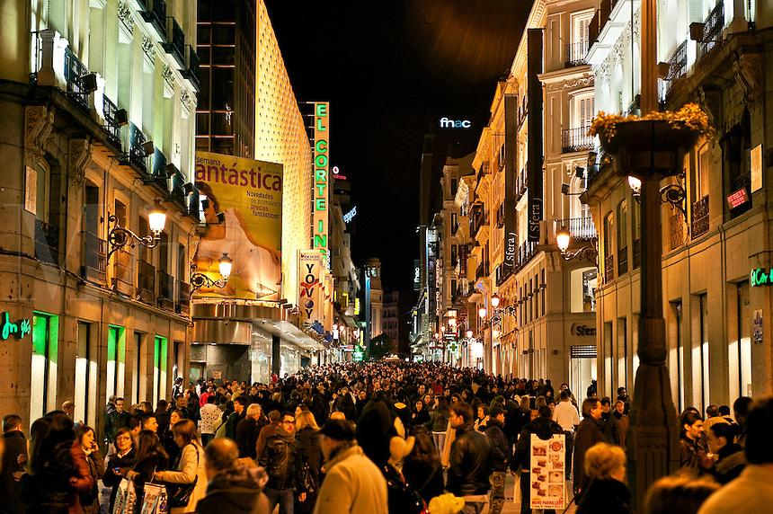 Crowded pedestrian street of shoppers, Calle de la Montera, Madrid, Spain
