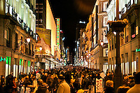 Crowded pedestrian street of shoppers, Calle de la Montera, Madrid, Spain