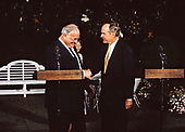 United States President George H.W. Bush shake hands after holding a joint press conference with Chancellor Helmut Kohl of West Germany at the White House in Washington, DC on June 8, 1990.<br /> Credit: Ron Sachs / CNP