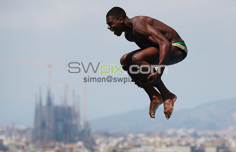 PICTURE BY VAUGHN RIDLEY/SWPIX.COM - Diving - 15th FINA World Championships 2013 - Monjtuic Municipal Swimming Pool, Barcelona, Spain - 20/07/13 - Jamaica's Yon Kinght-Wisdom competes in the Men's 1m Springboard Preliminary.