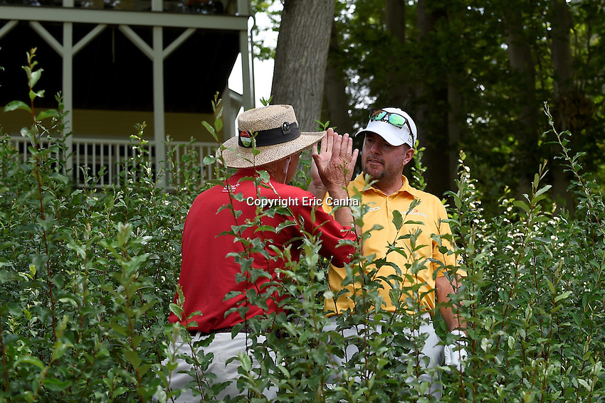 August 6, 2016: Robert Garrigus high fives a volunteer who found his ball in the shrubbery as he played the 15th hole during day three of the PGA Travelers Championship held at TPC River Highlands in Cromwell CT. Eric Canha/CSM
