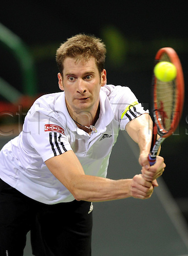 03.01.2014. Doha, Qatar.  Florian Mayer of Germany returns the ball during the men s singles semifinal match against Gael Monfils of France in Qatar Open tennis tournament, Jan. 3, 2014. Mayer lost 0-2.
