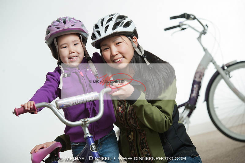 Halene and daugher Riley practicing bicycle safety.