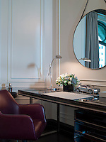A stylish desk is accommodated in a corner of the suite living room