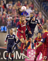 Real Salt Lake forward Alvaro Saborio (15) and New England Revolution defender Pat Phelan (28) battle for head ball. Real Salt Lake defeated the New England Revolution, 2-1, at Gillette Stadium on October 2, 2010.
