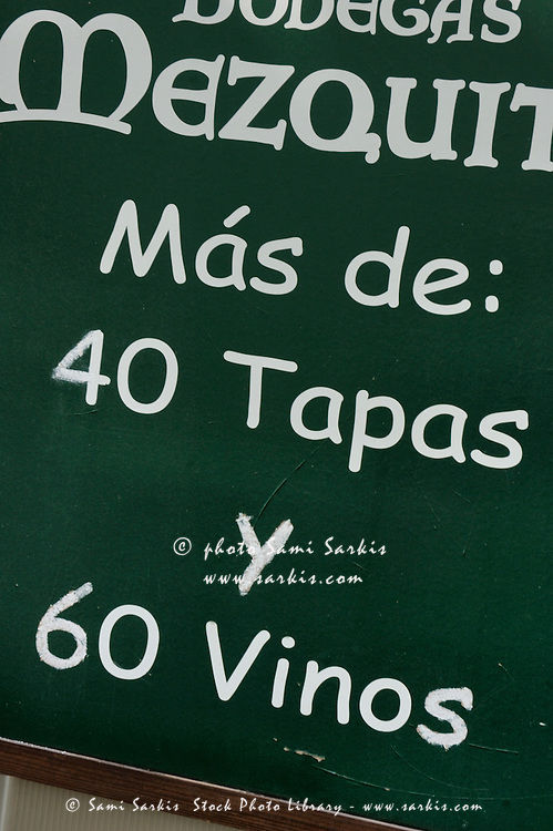 Restaurant board advertising tapas and wines in Cordoba, Andalusia, Spain.