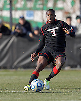 Northeastern University defender Ambry Moss (3) reacts to loose ball at midfield. .NCAA Tournament. University of Connecticut (white) defeated Northeastern University (black), 1-0, at Morrone Stadium at University of Connecticut on November 18, 2012.