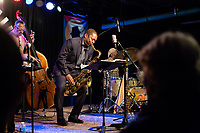 Ravi Coltrane plays the tenor saxophone with the Ethan Iverson Trio for Thelonious Monk's 100th birthday for during the Monk @ 100 festival at the Durham Fruit and Produce Company in Durham, NC Thursday, October 26, 2017. (Justin Cook for The New York Times)