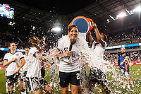 United States (USA) midfielder Tobin Heath (17) and forward Sydney Leroux (2) give a Gatorade bath to forward Abby Wambach (20). The women's national team of the United States defeated the Korea Republic 5-0 during an international friendly at Red Bull Arena in Harrison, NJ, on June 20, 2013.