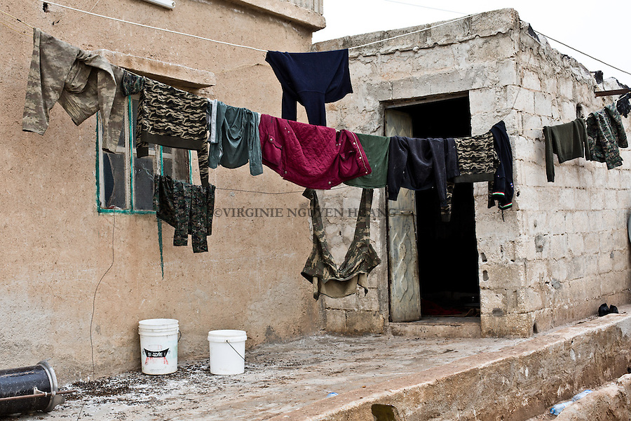 SYRIA: YPG fighters clothes dry in their rear base of the villages to the front lines surrounding the town of Tal Abyad.<br /> <br /> SYRIA: des v&ecirc;tements de combattants YPG s&egrave;chent dans leur base arri&egrave;re des lignes de front des villages entourant la ville de Tal Abyad.