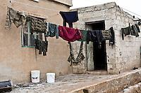 SYRIA: YPG fighters clothes dry in their rear base of the villages to the front lines surrounding the town of Tal Abyad.<br /> <br /> SYRIA: des vêtements de combattants YPG sèchent dans leur base arrière des lignes de front des villages entourant la ville de Tal Abyad.