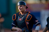 Catcher John Hicks #8 of the Virginia Cavaliers on defense against the Florida State Seminoles at the 2010 ACC Baseball Tournament at NewBridge Bank Park May 27, 2010, in Greensboro, North Carolina.  The Seminoles defeated the Cavaliers 11-4.  Photo by Brian Westerholt / Four Seam Images