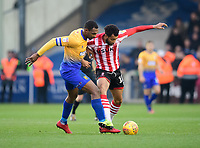 Lincoln City's Matt Green vies for possession with Mansfield Town's Krystian Pearce<br /> <br /> Photographer Chris Vaughan/CameraSport<br /> <br /> The EFL Sky Bet League Two - Lincoln City v Mansfield Town - Saturday 24th November 2018 - Sincil Bank - Lincoln<br /> <br /> World Copyright &copy; 2018 CameraSport. All rights reserved. 43 Linden Ave. Countesthorpe. Leicester. England. LE8 5PG - Tel: +44 (0) 116 277 4147 - admin@camerasport.com - www.camerasport.com