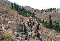 Outdoor Life Editor Andrew McKean poses with a prized mule deer after a kill on Greyback Ridge in the Hoeback Drainage of Wyoming Region H, outside of Alpine, Wyoming, Monday, September 21, 2015. <br /> <br /> Photo by Matt Nager