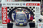 Pix: Shaun Flannery/shaunflanneryphotography.com...COPYRIGHT PICTURE>>SHAUN FLANNERY>01302-570814>>07778315553>>..1995 Network Q RAC Rally..19th November - 22nd November 1995..Celebrating victory on the podium..1995 FIA World Rally Championship for Drivers.1995 FIA World Rally Championship for Manufacturers .Colin McRae and Derek Ringer..Subaru Impreza 555.